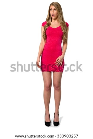 Serious Caucasian young woman with long light blond hair in evening outfit with hands on thighs - Isolated