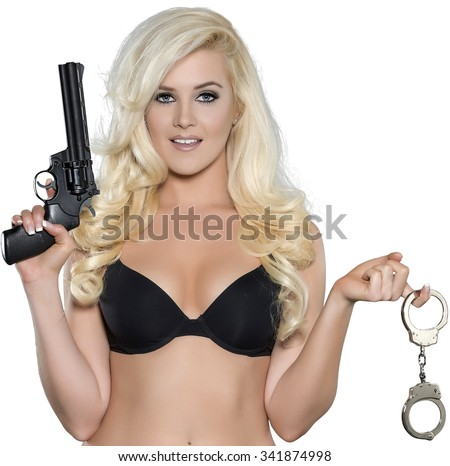 Serious Caucasian young woman with long light blond hair in intimate/nude outfit holding handcuffs - Isolated - stock photo