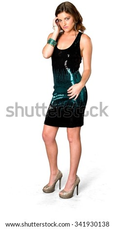Serious Caucasian young woman with long medium brown hair in evening outfit fashion pose - Isolated