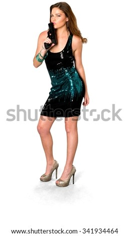 Serious Caucasian young woman with long medium brown hair in evening outfit holding handgun - Isolated