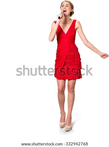 Serious Caucasian young woman with medium blond hair in evening outfit holding microphone and singing - Isolated - stock photo