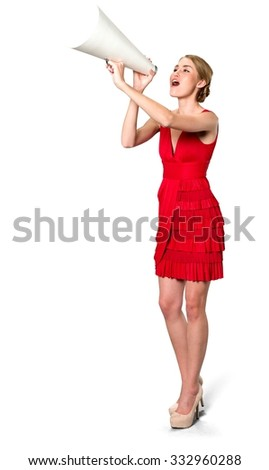 Serious Caucasian young woman with medium blond hair in evening outfit using megaphone - Isolated - stock photo