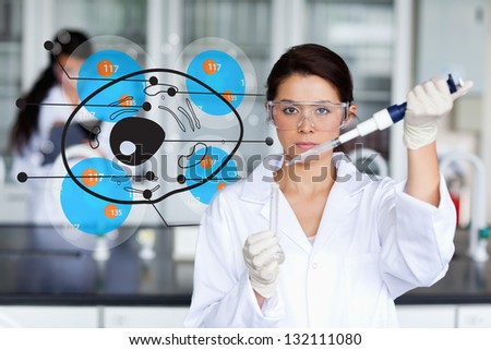 Serious chemist working with hologrpahic cell interface - stock photo