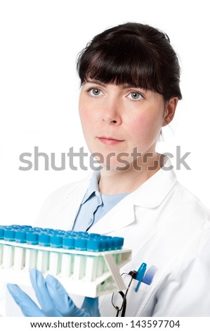 Serious clinitian, nurse or technical assistant with tray of samples on white background - stock photo
