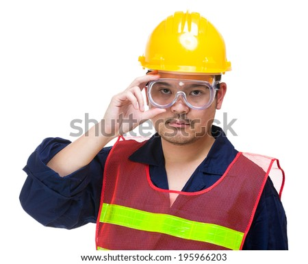Serious construction worker wearing goggles
