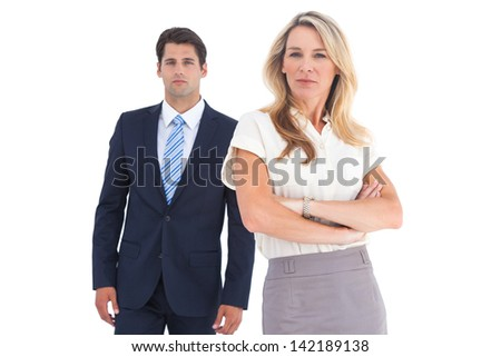 Serious coworkers looking at the camera on a white background - stock photo