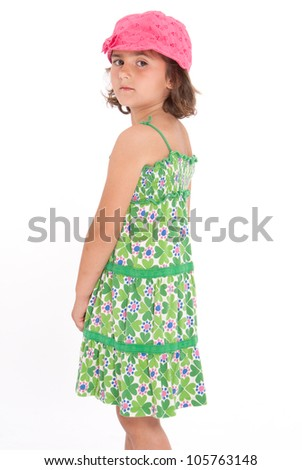 Serious cute little girl with her back to the camera - stock photo