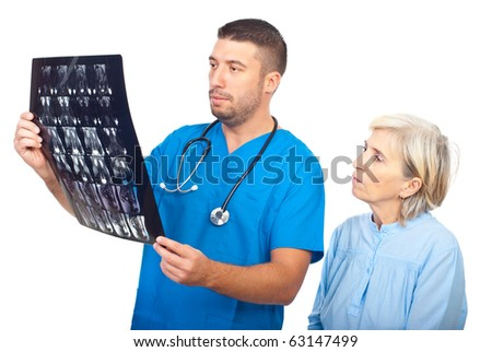 Serious doctor man showing results of magnetic resonance imaginig to a senior patient and both being worried isolated on white background - stock photo