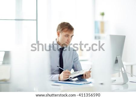 Serious employee - stock photo
