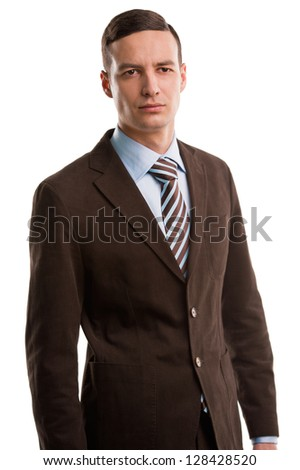 Serious executive in suit posing isolated on white background