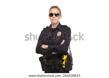 Serious female police officer posing with arms crossed against white background - stock photo