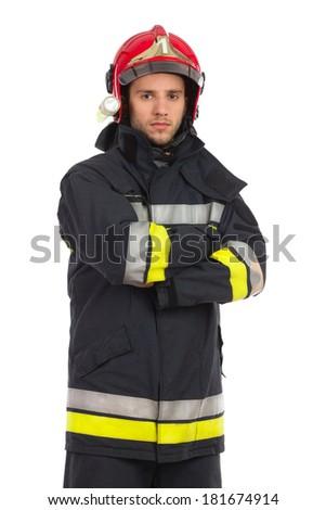 Serious firefighter posing. Three quarter length studio shot isolated on white. - stock photo