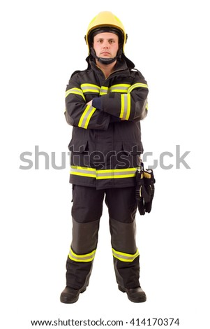Serious firefighter posing with arms crossed. Full length studio shot isolated on white. - stock photo