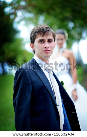 serious groom - stock photo