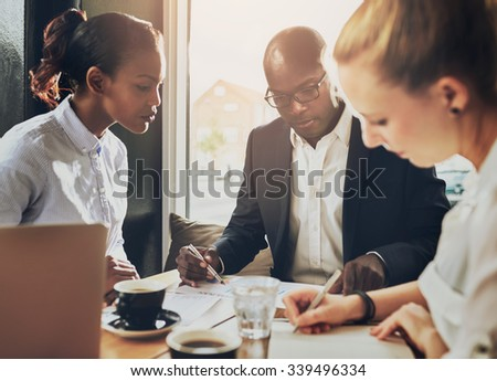 Serious group of business people working, multi ethnic group, business, entrepreneur, start up concept - stock photo