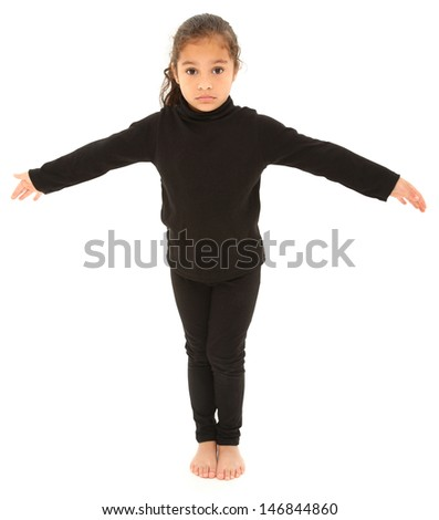 Serious Hispanic Preschooler Standing arms outstretched on White Floor. Clipping path. - stock photo