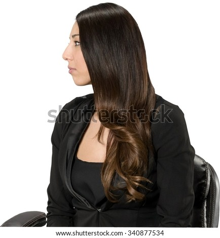 Serious Hispanic young woman with long dark brown hair in casual outfit - Isolated