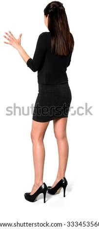 Serious Hispanic young woman with long dark brown hair in casual outfit talking with hands - Isolated