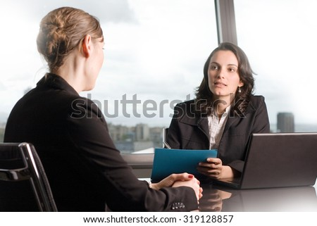 Serious job interview of a woman with a business recruiter