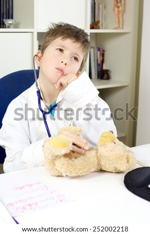 Serious kid doctor at work