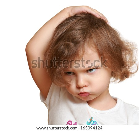 Serious kid thinking about and holding head the hand with fun face isolated on white - stock photo