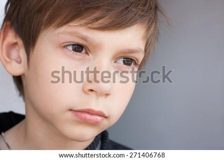 serious little boy - stock photo