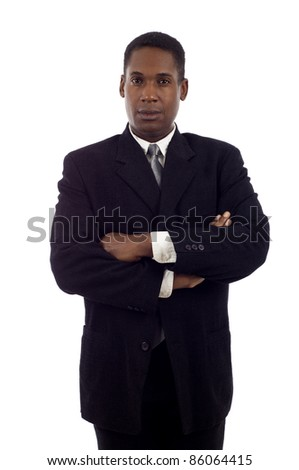 Serious looking African American business man standing with hands folded isolated white background - stock photo
