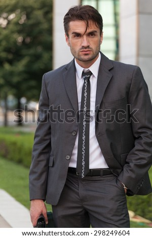 serious looking businessman on the street - stock photo
