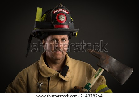 Serious looking confident firefighter Headshot Portrait on Dark Background
