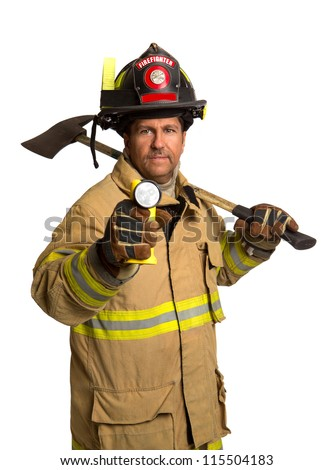 Serious looking confident firefighter standing holding ax and flash light portrait isolated on white
