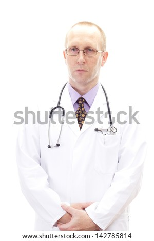 Serious looking male medical doctor - stock photo