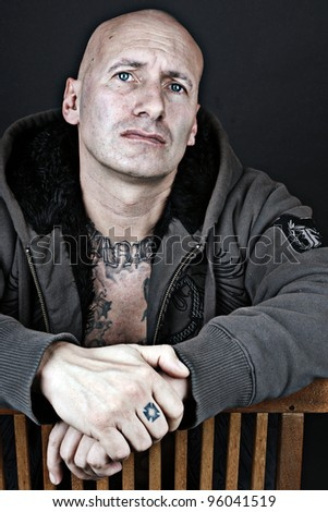 Serious looking man with blue eyes over black - stock photo