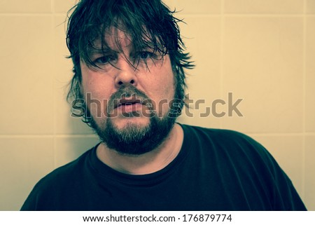 Serious looking man with wet hair