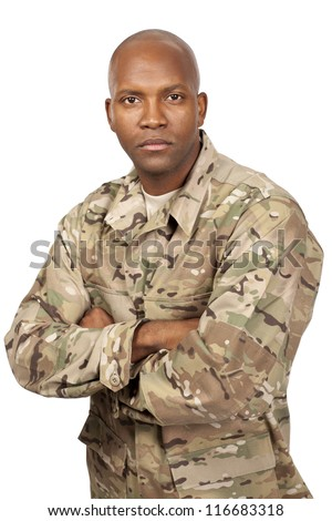 Serious looking serviceman with his arms crossed - stock photo