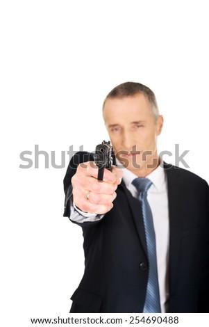 Serious mafia agent aiming by handgun. - stock photo