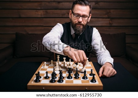 Serious male chess player makes victory move