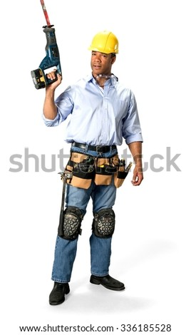 Serious Male Construction Worker with short black hair in uniform holding reciprocating saw - Isolated - stock photo