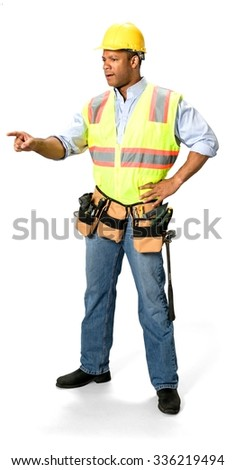 Serious Male Construction Worker with short black hair in uniform pointing using finger - Isolated