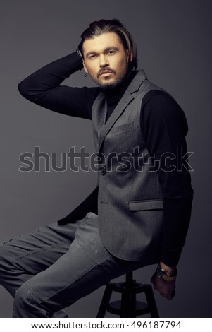 Serious male model in studio in casual clothing