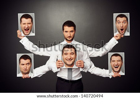 serious man choosing mood. concept photo over dark background - stock photo