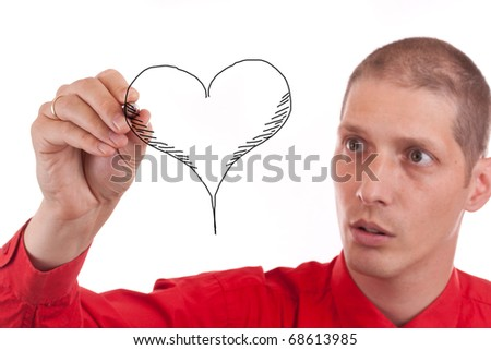 Serious man designing heart isolated on white