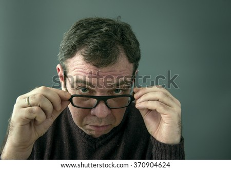 Serious man in glasses. - stock photo