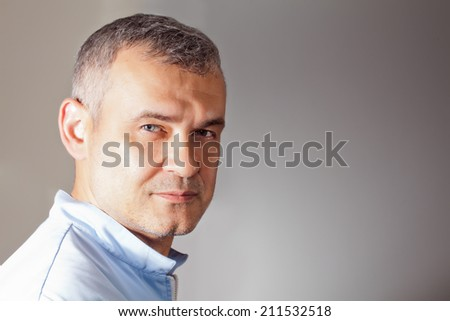 serious man looking at the camera  - stock photo