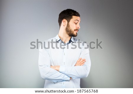 serious man looking in one side on grey background - stock photo
