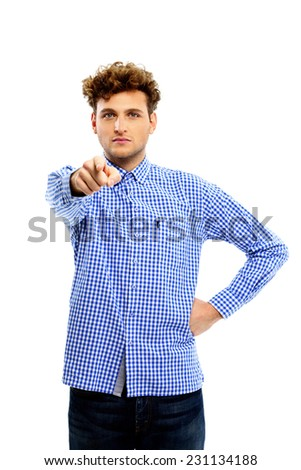 Serious man pointing at you over white background - stock photo