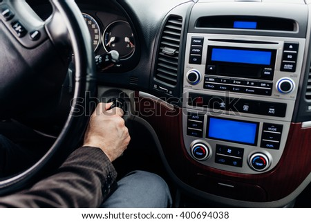 Serious man sitting at back seat of the car and have phone call. Closeup of rear view mirror. - stock photo