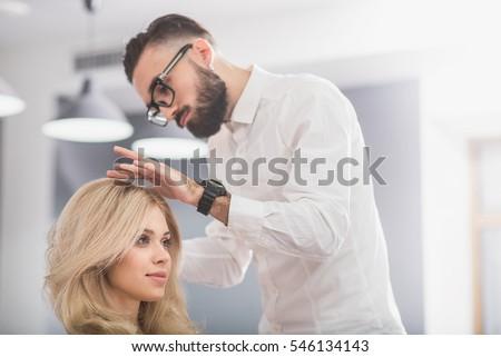 Serious man with beard at hairdresser salon