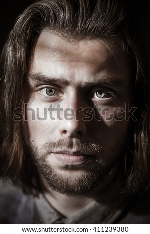 serious man with long hair and beard, portrait,