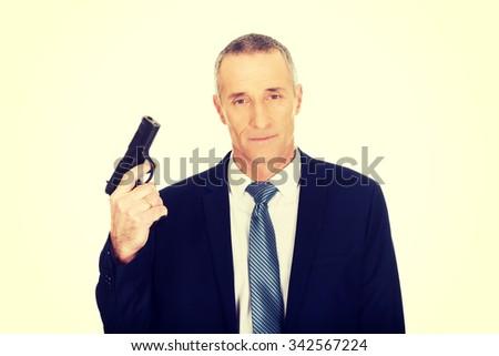 Serious mature mafia agent with handgun. - stock photo
