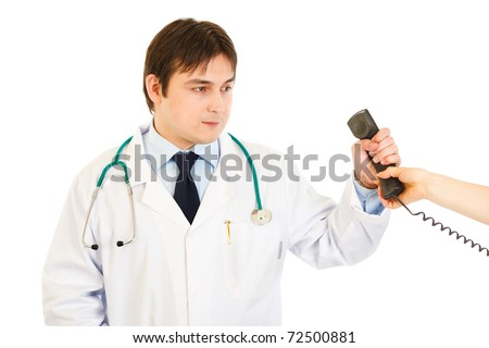 Serious medical doctor taking phone from secretary  isolated on white - stock photo